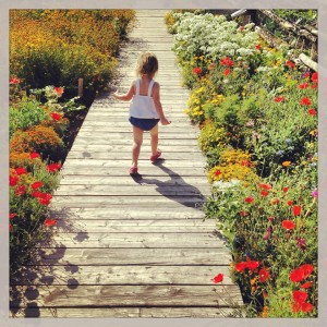 Laney on boardwalk with flowers