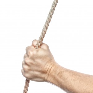 Hand holds a thick rope. On a white background.