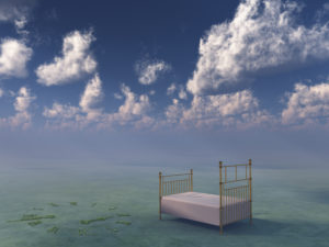 Bed in surreal peaceful landscape